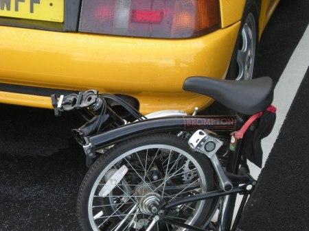 Brompton Bicycle by a Lotus Elan
