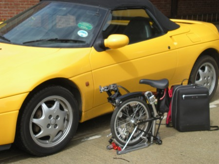 Lotus Elan, Brompton Bicycle and a Paul Smith Case