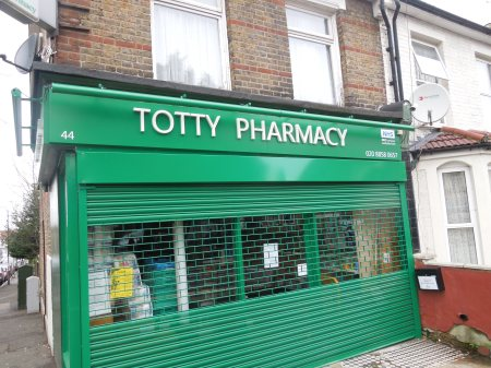A Pharmacy With Young Assistants Wearing High Heels?
