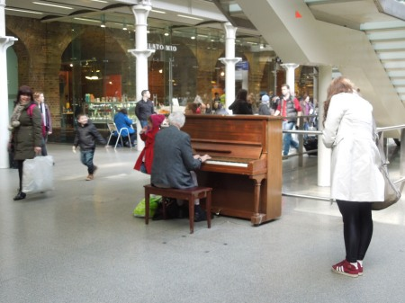 Piano And Pianist At St. Pancras Station
