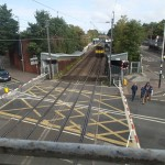 A Class 317 Approaching The Level Crossing