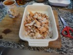 2. Tear The Chicken Into Bite-Size Pieces In A 1.5 Litre Dish