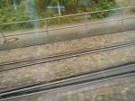 Tram And Train Tracks Merge