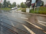 Trams And Trains Share A Level Crossing