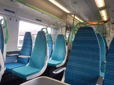 A Class 387 Interior With Comfortable Seats And Tables